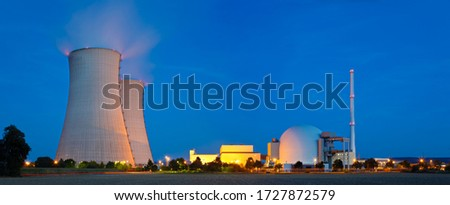Panoramic view of a nuclear power plant with night blue sky. Royalty-Free Stock Photo #1727872579