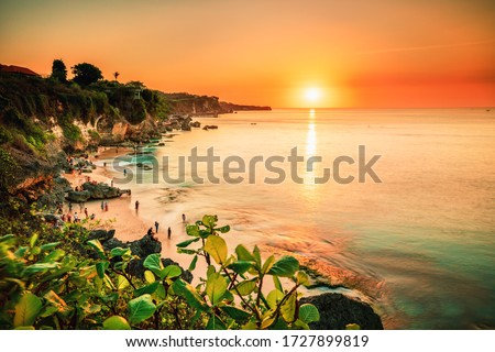 Scenic sea landscape, Bali. High cliff on tropical Pantai beach in Bali, Indonesia. Tropical nature of Bali, Indonesia. Beautiful blue sea water, white sand beach and green tropics of Bali shoreline #1727899819