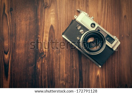 Vintage camera on wooden background Royalty-Free Stock Photo #172791128