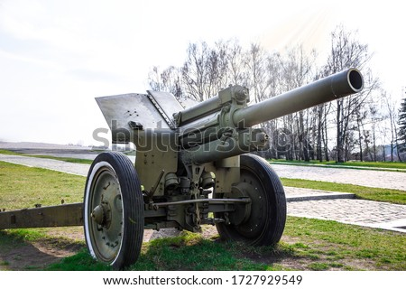 Artillery, green gun, artillery cannon gun ordnance for soldier warrior in the world war in the park, anti-tank guns during the Second world war obsolete gun #1727929549