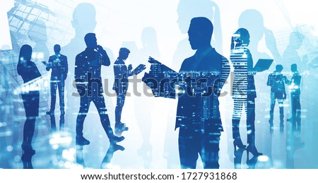 Silhouette of businessman with clipboard and his teammates working together in blurry city with double exposure of night cityscape. Concept of leadership and teamwork. Toned image