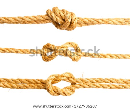 three nautical knots made of rough natural rope isolated on white background Royalty-Free Stock Photo #1727936287