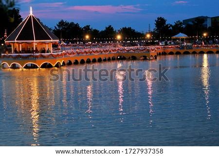 ฺBuilding,The light on the bridge have the reflected picture on the pool and the twilight in the sky.