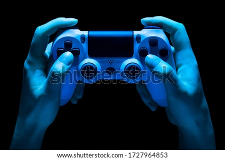 Hyman hands video game gamepad in neon lights isolated on a black background with clipping path