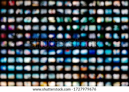 Blurred colorful LED illuminated bokeh background on Grid frame arrangement system. Abstract defocused illuminated backdrop with light bokeh on rectangular grid pattern dispaly.