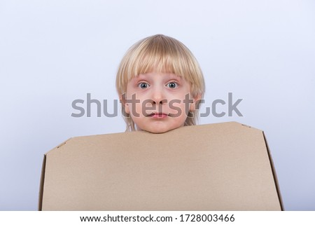 Surprised upset fair-haired boy with box in hand on white background. Pizza delivery. #1728003466