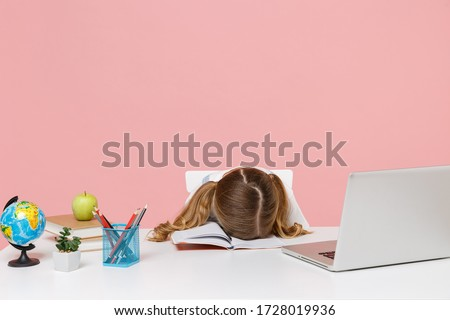 Tired little kid schoolgirl 12-13 years old sit study at desk with pc laptop isolated on pink background. School distance education at home during quarantine concept. Sleeping with head down on desk #1728019936