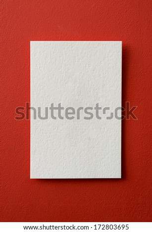 paper card on a red background