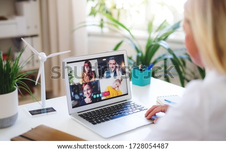 Senior businesswoman with laptop indoors in home office, business call concept. #1728054487