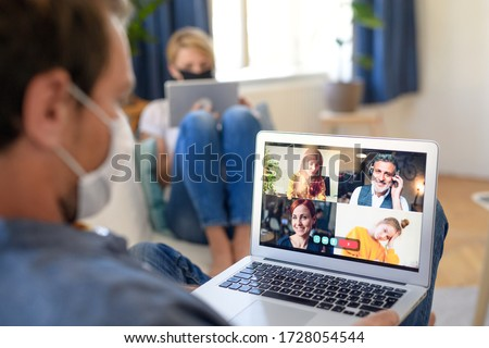 Mature businessman and colleague with face mask indoors working in office. #1728054544