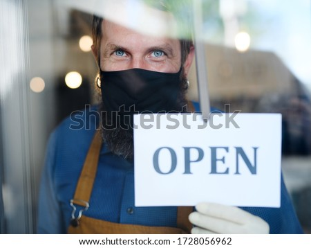 Coffee shop man owner with face mask, open after lockdown quarantine. #1728056962