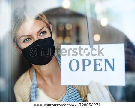 Coffee shop woman owner with face mask, open after lockdown quarantine. #1728056971