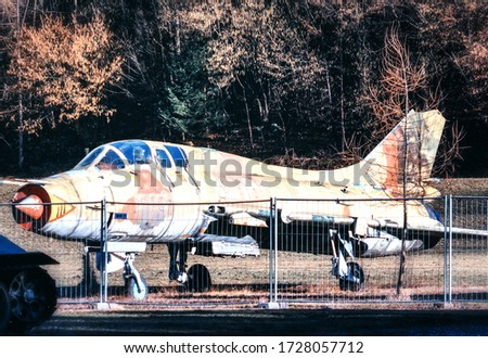 A picture from the abandoned military base full of old rusty fighter jets from the soviet era. -
