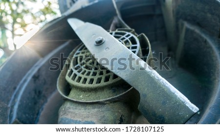 lawn mower blade close up Royalty-Free Stock Photo #1728107125
