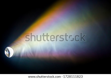rainbow projector spotlight with light beam for movie and cinema at night on smoke texture . Royalty-Free Stock Photo #1728111823