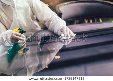 Professional workers in hazmat suits disinfecting indoor of cafe or restaurant, pandemic health risk, coronavirus #1728147313
