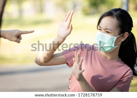 Problems of bullying at school,sad stressed asian girl student in medical mask,hand pointing finger to scared schoolgirl,bullying victim and hate,anti racism and stop xenophobia,bullied by society #1728178759