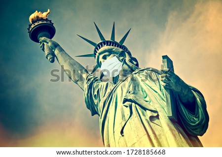 Statue of Liberty wearing a surgical mask. New coronavirus, covid-19 in New York and USA epidemic crisis concept Royalty-Free Stock Photo #1728185668