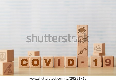 Covid-19 message on wooden cubes #1728231715