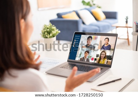Young Asian businesswoman work at home and virtual video conference meeting with colleagues business people, online working, video call due to social distancing #1728250150
