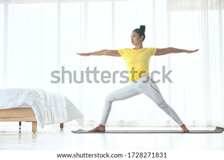 Skinny woman wear yellow sport t-shirt practice yoga exercises for relaxing in the bedroom , healthy concept #1728271831