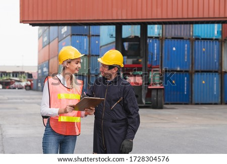 Male engineer logistic staff sign approve on Containers box checklists documents at from Cargo freight ship at Cargo container shipping