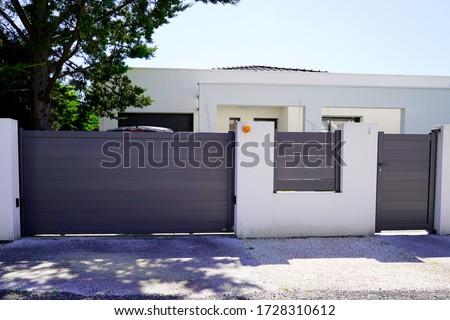 Aluminum modern home green grey gate portal of suburb door house Royalty-Free Stock Photo #1728310612