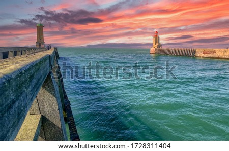 Dramatic sunset over the Lighthouses and guidance at the entrance of the Port of Fecamp, Seine-Maritime, Normandy, France, Europe on the coast of Normandy in the English Channel in Spring  #1728311404
