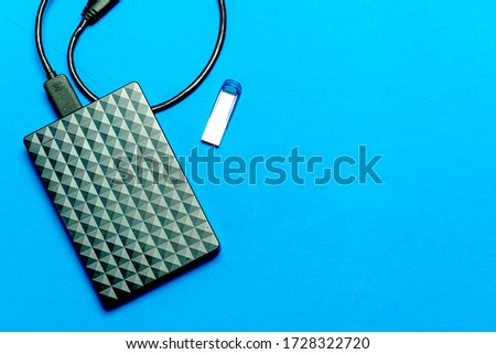 top view flat lau of a pen drive and a hard disk in in a colorful blue #1728322720