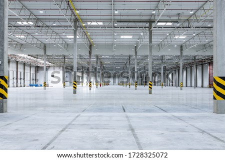 Clean and empty industrial hall in detail for supporting poles #1728325072