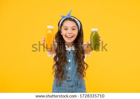 Berries in my bottle. Fruit energy. Smiling kid hold smoothie bottles. Healthy food. Vitamin nutrition. Fresh smoothie. Girl drinking orange fresh smoothie. Vegetarian concept. Vitamin juice. #1728335710