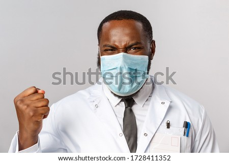 Healthcare, medicine and hospital treatment concept. Close-up portrait of triumphing, rejoicing african-american doctor finally fought disease got positive test results, fist pump and saying yes #1728411352