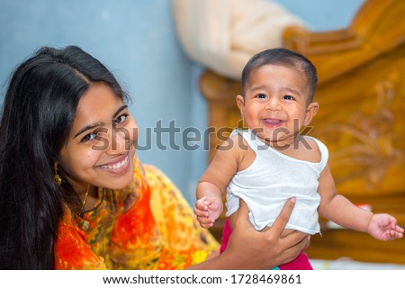 A asian baby and her mothers Naughty laughter picture at home.
