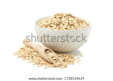Bowl and scoop with oatmeal flakes isolated on white background #1728524629