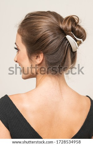 Model With Hair Clips, posing, close up.  Royalty-Free Stock Photo #1728534958