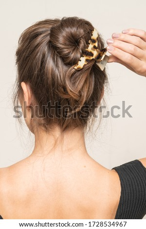 Model With Hair Clips, posing, close up.  #1728534967