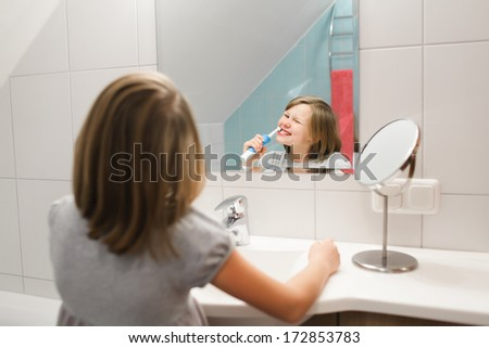 Little girl brushing her teeth. #172853783