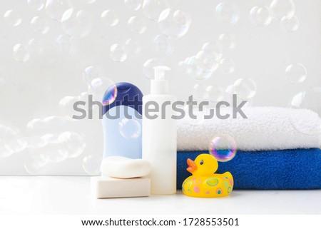 baby bath products, baby care, Yellow rubber duck for bath games. Soap bubbles, bath foam, soap bubbles. #1728553501