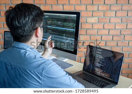 Young Professional programmer working at developing programming and website working in a software develop company office, writing codes and typing data code, Programming with HTML, PHP and javascript. #1728589495