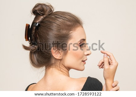 Beautiful girl with makeup and long hair With Hair Clips  Royalty-Free Stock Photo #1728593122