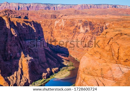 Horseshoe Bend is a beautiful meander of the Colorado River. Deep canyon of red sandstone. USA, Arizona, Glen Canyon Recreation Area. Concept of active and photo tourism #1728600724