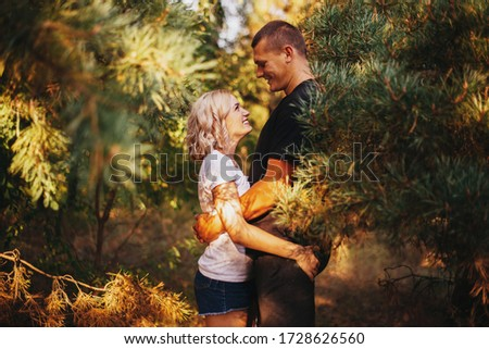 Tall young man and low girl in the forest Royalty-Free Stock Photo #1728626560