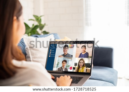 Young Asian businesswoman work at home and virtual video conference meeting with colleagues business people, online working, video call due to social distancing #1728718525
