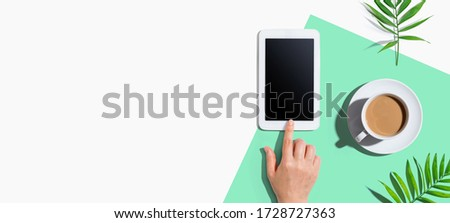 Person using a tablet computer from above #1728727363