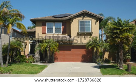 Typical generic suburban single family tract home with built-in garage in California Royalty-Free Stock Photo #1728736828