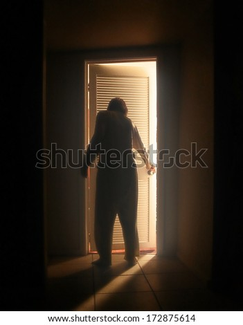 a person looking into a room at night #172875614