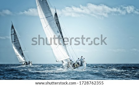 Sailing yachts regatta. Sailboats under sail in the race Royalty-Free Stock Photo #1728762355