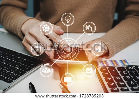5G. woman hand using digital mobile phone with virtual graphic icon, laptop computer and report on desk at home office, digital marketing, work from home, business finance, network technology concept Royalty-Free Stock Photo #1728785203