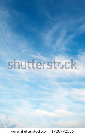 Natural sunny blue sky background with beautiful puffy white cumulus clouds & fluffy cirrus cloudscape on bright daylight horizon in tropical summer sunlight & exotic sun ray at sunny & sunshine day #1728972535