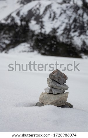 stones balance on the snow. #1728986074
